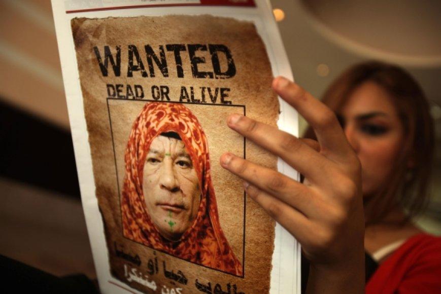 Interpolas ragina suimti Muamarą Kadhafi.