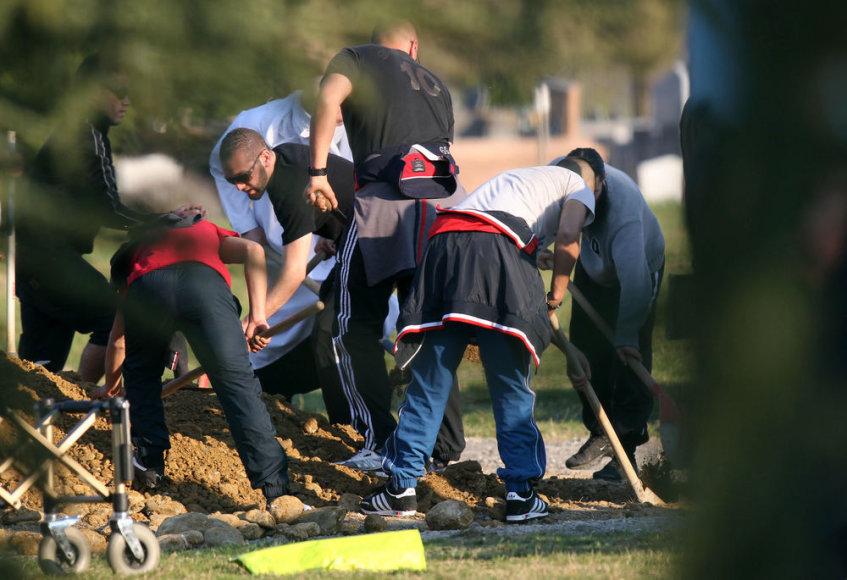 Islamo ekstremisto Mohamedo Merah (Mohamedo Mera) palaikai ketvirtadienį palaidoti jo gimtojo Tulūzos miesto kapinėse