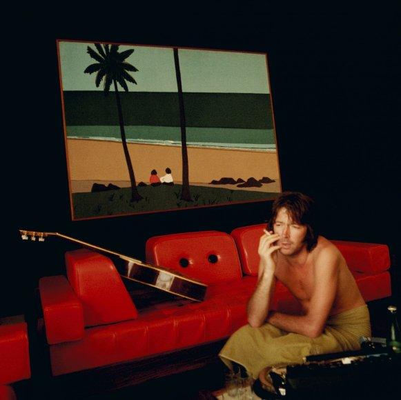 """""""Scanpix""""/""""Caters News Agency"""" nuotr./Ericas Claptonas savo viešbučio kambaryje (1974 m.)"""