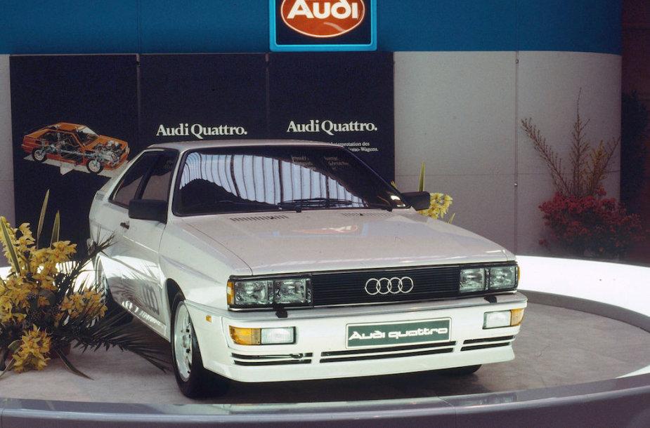 """1980 m. pavasarį vykusioje tarptautinėje Ženevos automobilių parodoje """"Audi"""" pristatė pirmąjį visų ratų pavara varomą """"quattro""""."""