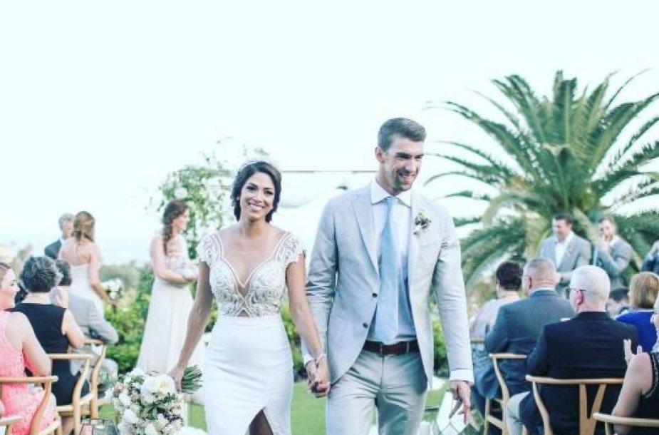 Michaelas Phelpsas su žmona Nicole Johnson