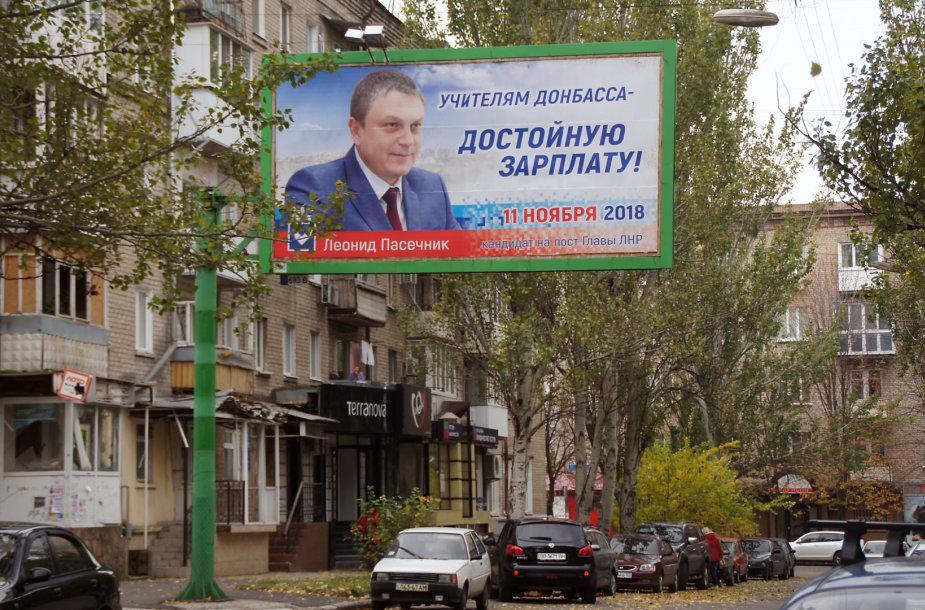 Plakatas, raginantis balsuoti už Leonidą Pasečniką