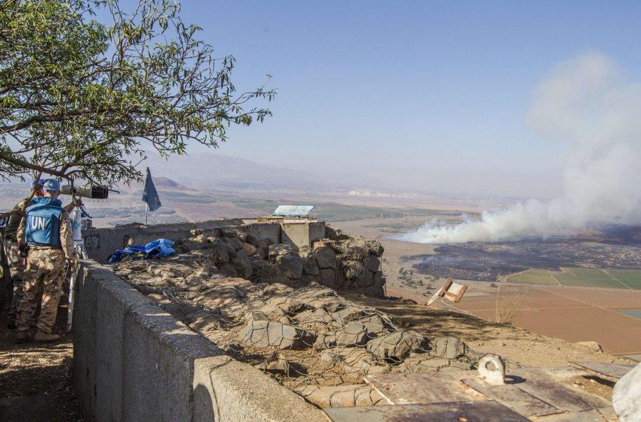 Žmonės Golano aukštumose stebi karą Sirijoje