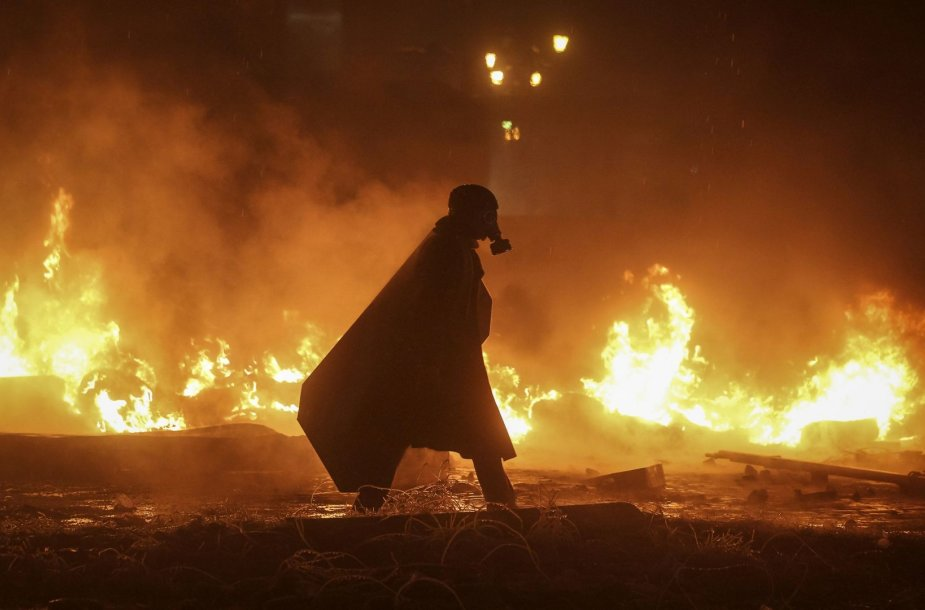 Protestuotojas su dujokauke