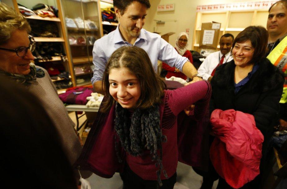 Kanadą pasiekė pirmoji pabėgėlių iš Sirijos grupė