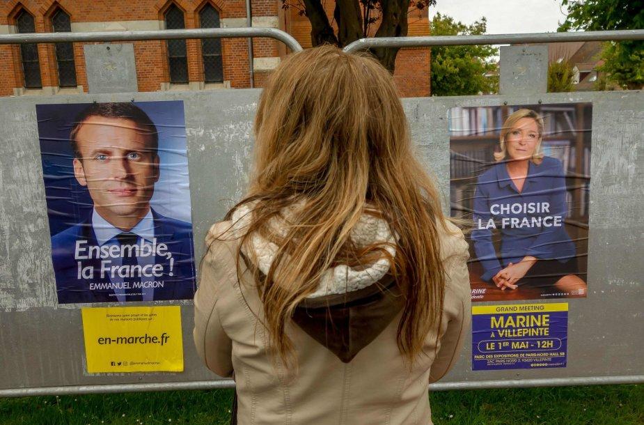 Emmanuelio Macrono ir Marine Le Pen rinkiminiai plakatai