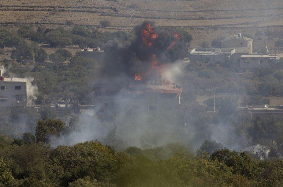Degantis namas Golano aukštumose, okupuotose Izraelio