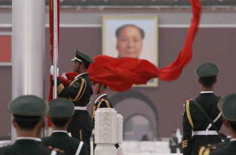 Pekino Tiananmenio aikštėje kabantis Mao Zedongo portretas šaliai primena buvusį lyderį, 1949 metais paskelbusį apie Kinijos Liaudies Respublikos įkūrimą.