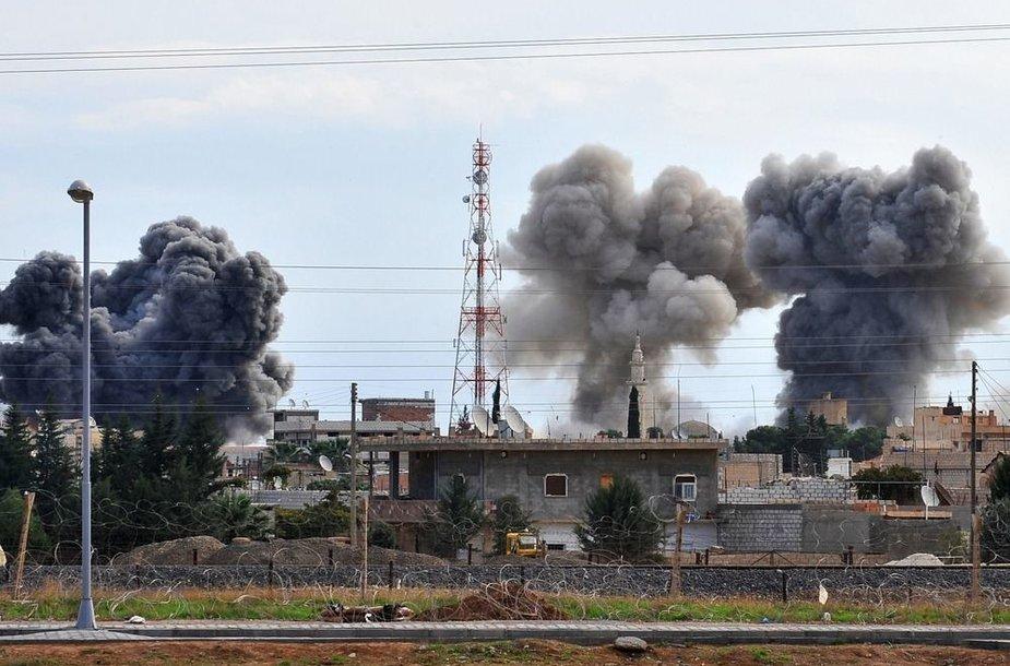Bombarduojamas Ras al Aino miestas
