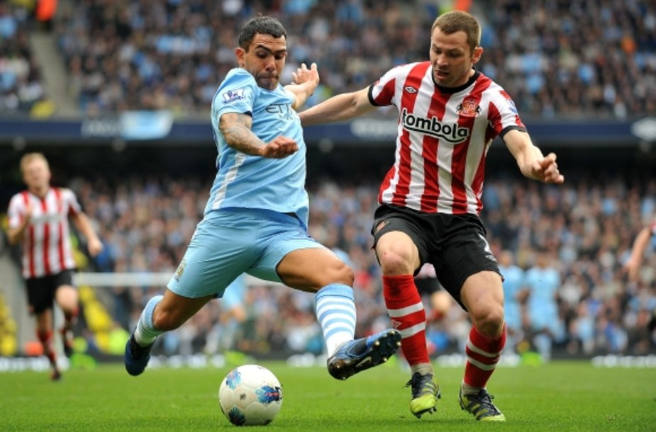 "Carlosas Tevezas (""Manchester City"") ir Philas Bardsley (""Sunderland"")"