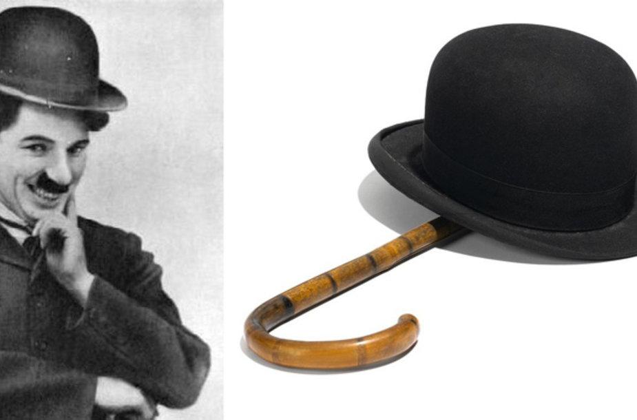 Charlie Chaplinas ir jo žymieji aksesuarai – skrybėlaitė ir lazdelė