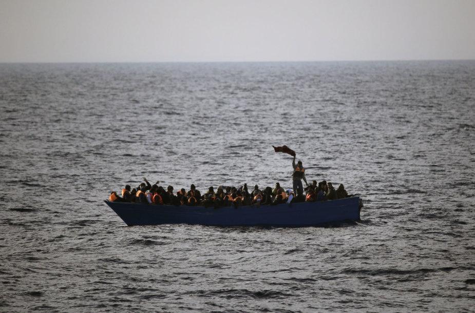 Migrantai valtyje