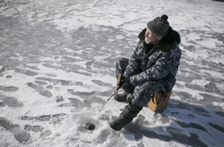 Ukrainos žvejys Azovo jūros pakrantėje