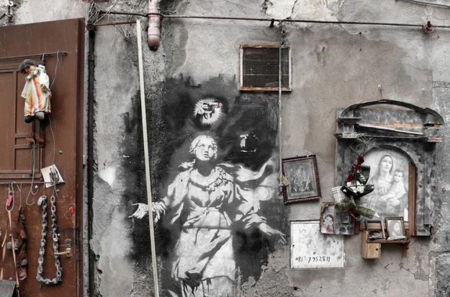 """Banksy darbas """"Madonna su pistoletu"""""""