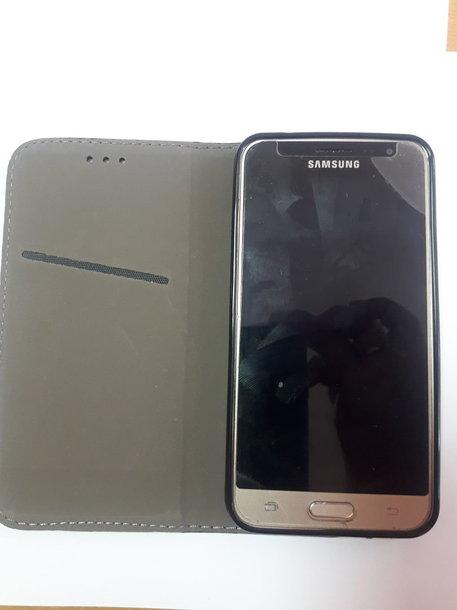 """Sąžininga alytiškė parduotuvės aikštelėje rado mobilųjį telefoną """"Samsung""""."""