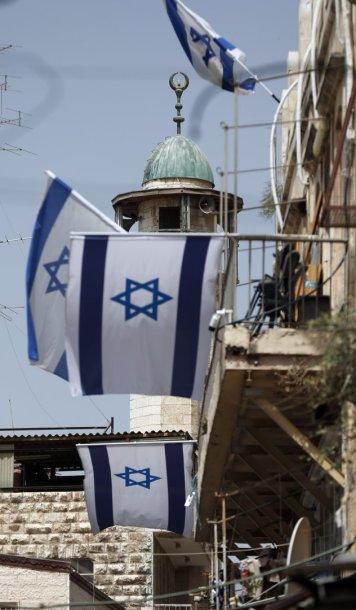 Izraelio vėliavos Jeruzalės senamiestyje